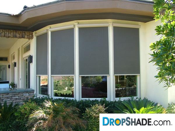 Motorized window retractable shades window solar drop for Motorized exterior solar window shades